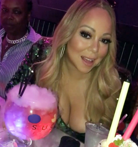 Braless Mariah's cleavage explodes from plunging dress | mcarchives.com