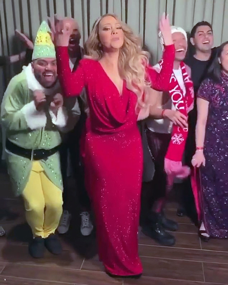 Mariah lip-syncs her seasonal hit with festive friends | mcarchives.com