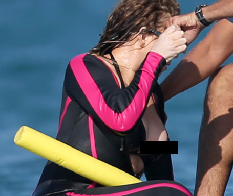 Mariah Careys Nipple Slips Out Of Wetsuit